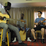 picture of students playing guitar and ukelele