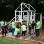 picture of a group of students painting a playground
