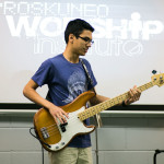 picture of a boy playing bass guitar