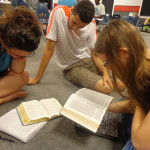 picture of three students studying the Bible together